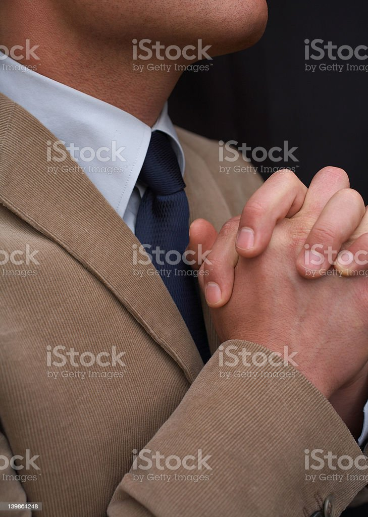 Cropped image of a business man Praying. royalty-free stock photo