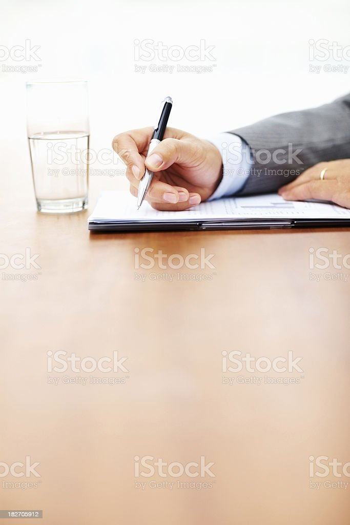 Cropped image of business man filling a form royalty-free stock photo