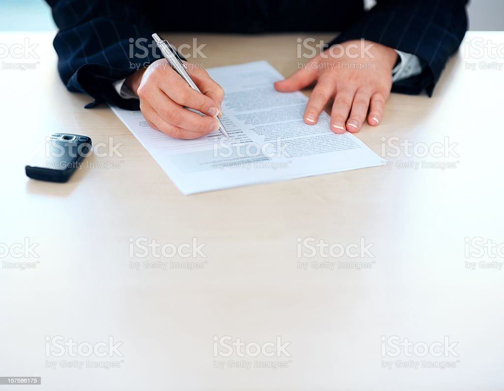 Cropped image of business woman filling a form royalty-free stock photo