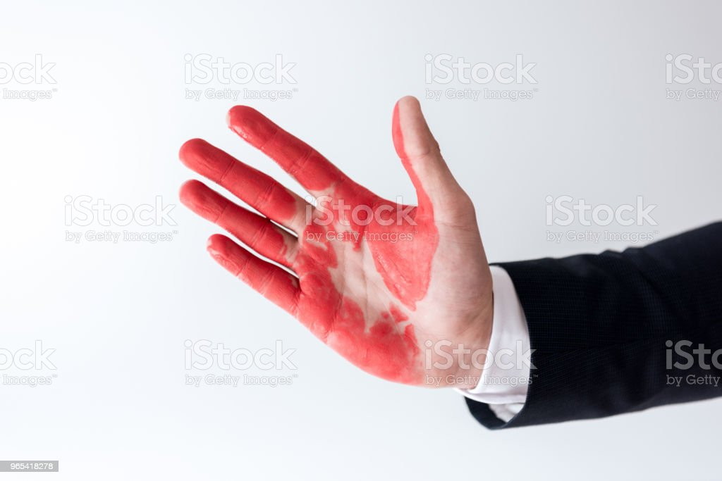 cropped image of businessman showing hand in red paint isolated on white zbiór zdjęć royalty-free