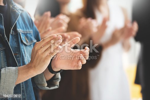 istock Cropped image of Creative designers audience applauding at a business seminar. 1042372612