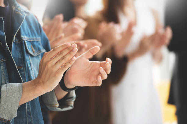 cropped image of creative designers audience applauding at a business seminar. - award stock photos and pictures
