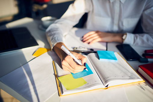 Cropped Image Of Creative Female Secretary Creating Planning For Executive Noting Important Meeting And Events Organizing Work Of Busy Boss While Sitting At Working Place In Coworking Office Stock Photo - Download Image Now