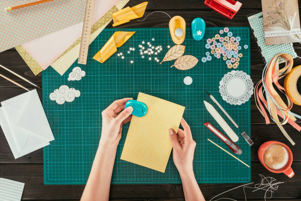 cropped image of designer - scrapbook stock photos and pictures