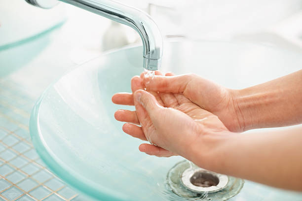 Cropped image of female washing hands stock photo