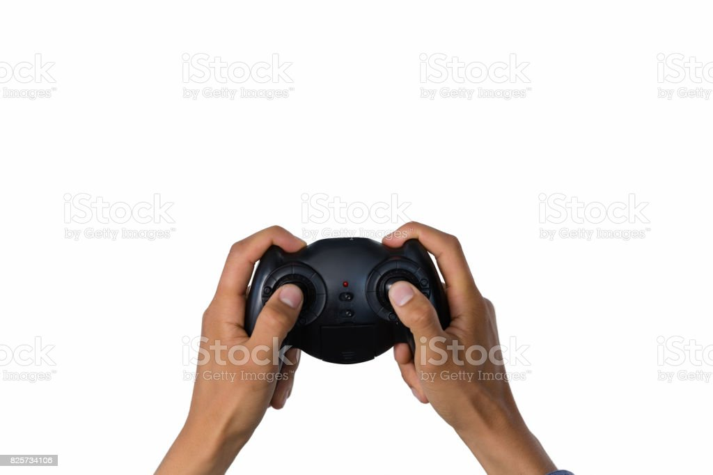 Cropped image of hand holding controller stock photo