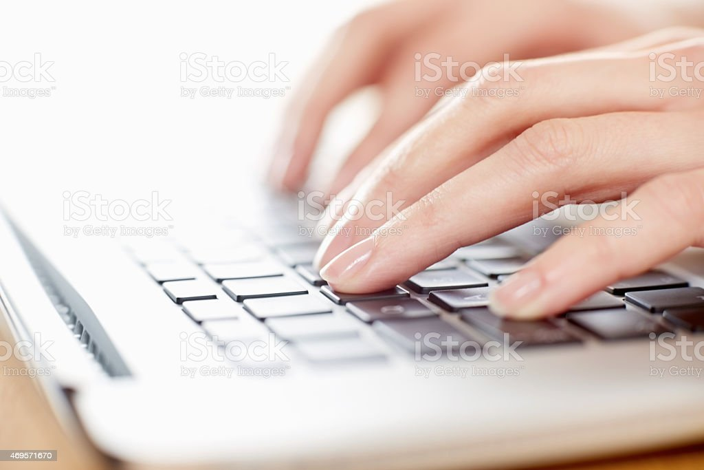 Cropped image of hands using laptop at home royalty-free stock photo