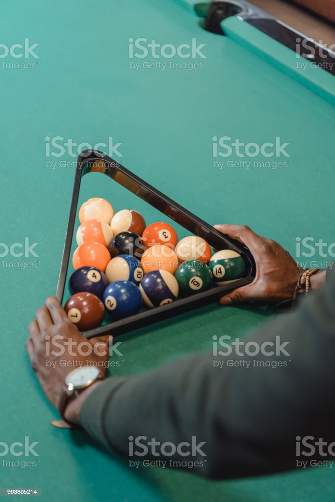 cropped image of male hands forming set of billiard balls by triangle - Royalty-free Adult Stock Photo