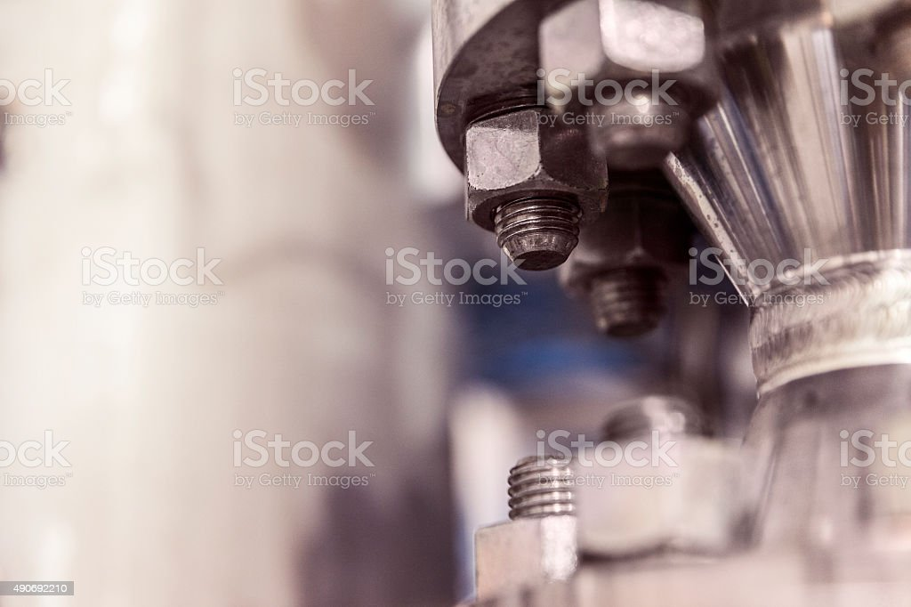 Cropped image of metallic machine in factory stock photo