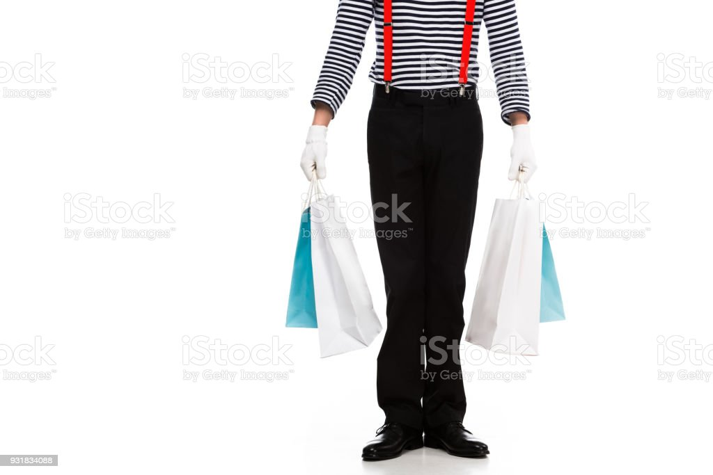 cropped image of mime standing with shopping bags isolated on white stock photo
