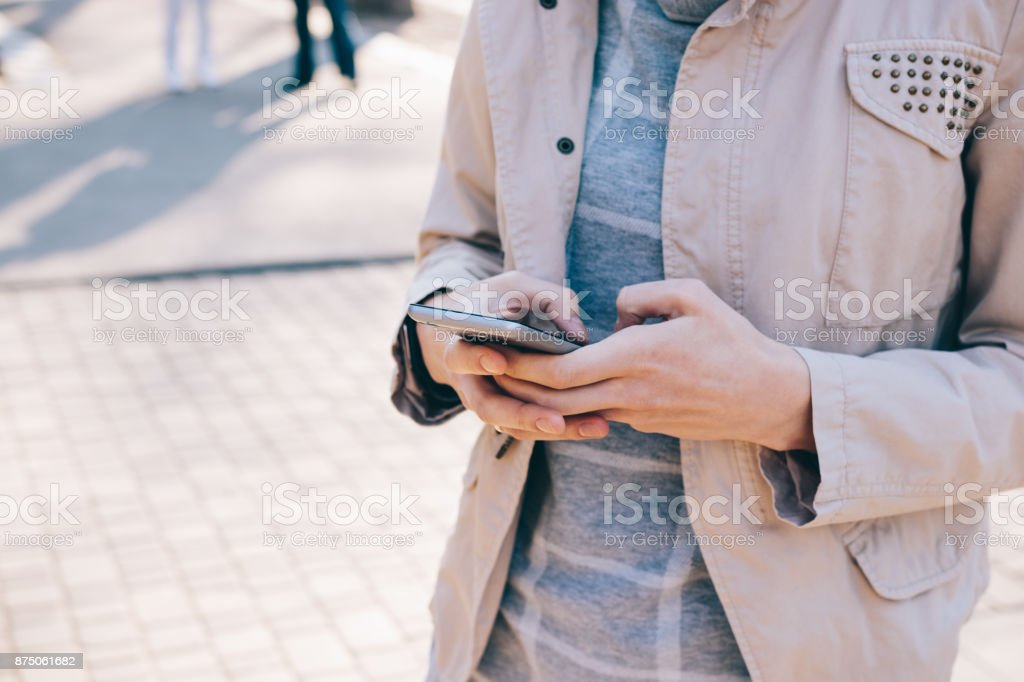 Cropped image of mobile phone in female hands stock photo