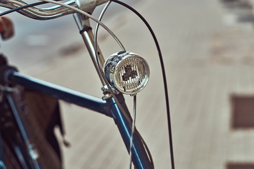 Cropped image of old retro city bicycle on the street.