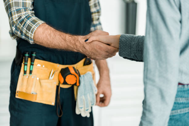 cropped image of plumber and customer shaking hands in kitchen cropped image of plumber and customer shaking hands in kitchen repairman stock pictures, royalty-free photos & images