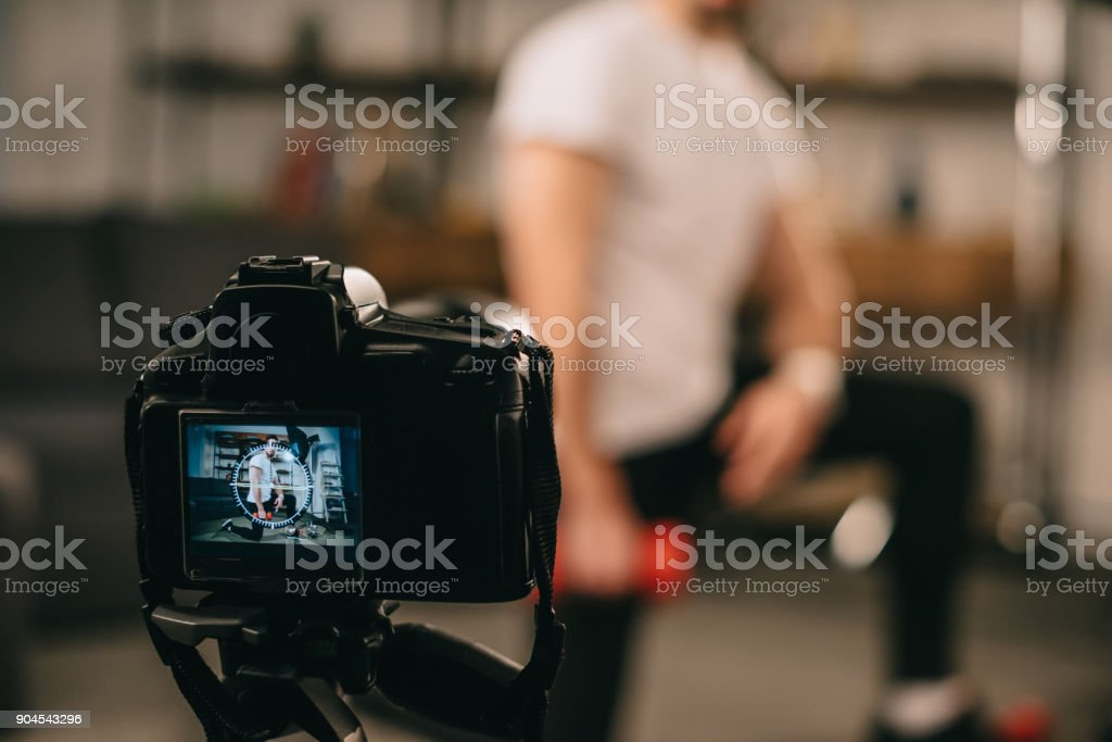 cropped image of sport blogger showing how to train with dumbbells stock photo