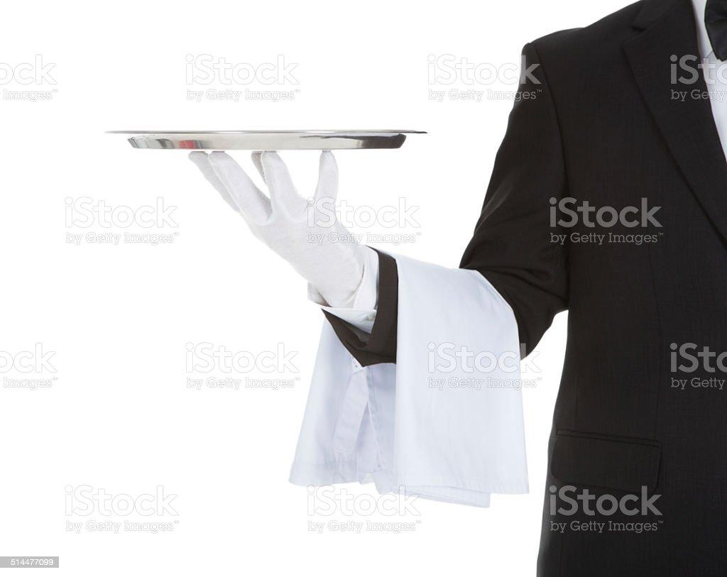 Cropped Image Of Waiter Holding Empty Tray stock photo