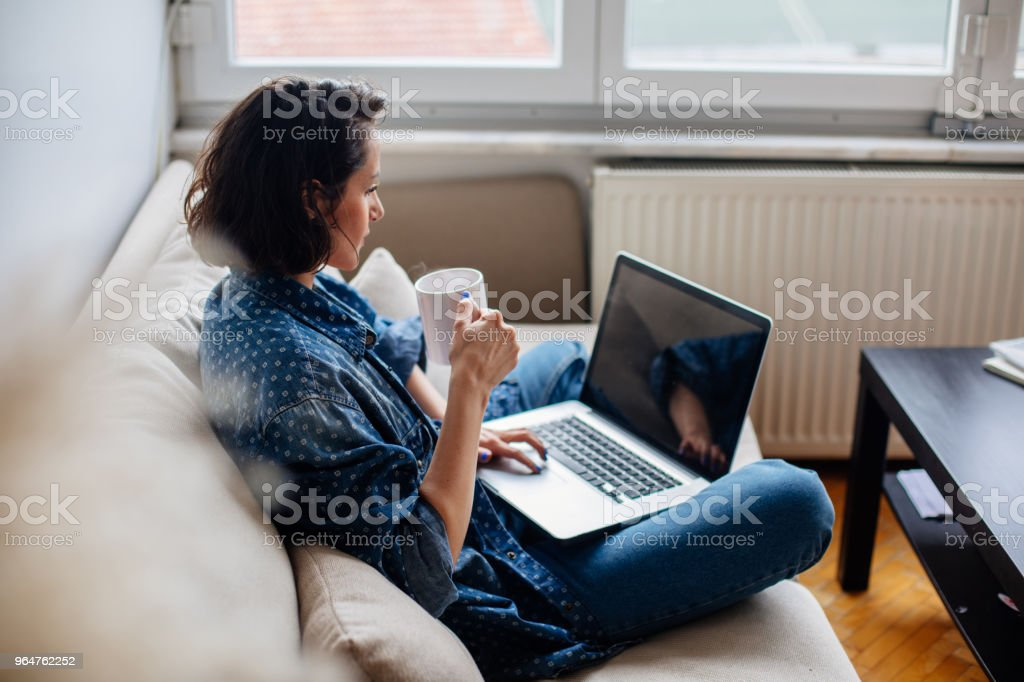 Cropped image of woman using laptop with blank screen royalty-free stock photo