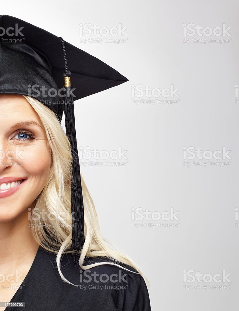Cropped image of young graduating student against white royalty-free stock photo