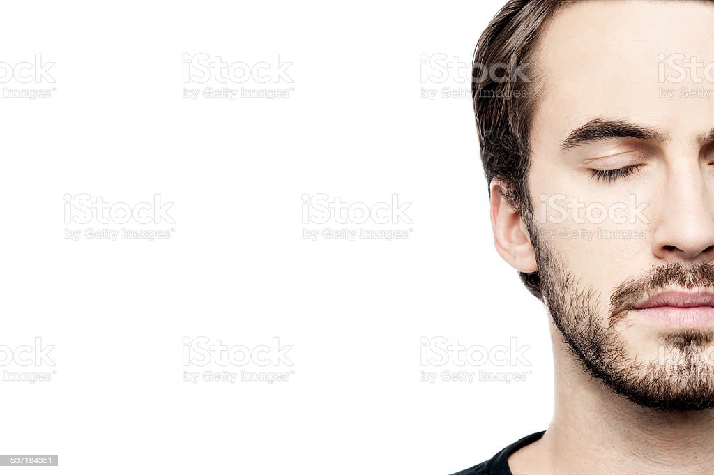 Cropped image of young man face stock photo