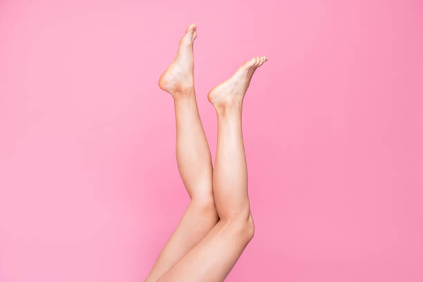 Cropped image view photo of long feminine fit thin slim clean clear legs ad advert healthy lifestyle isolated over pink pastel background Cropped image view photo of long feminine fit thin slim clean clear legs ad advert healthy lifestyle isolated over pink pastel background human leg stock pictures, royalty-free photos & images
