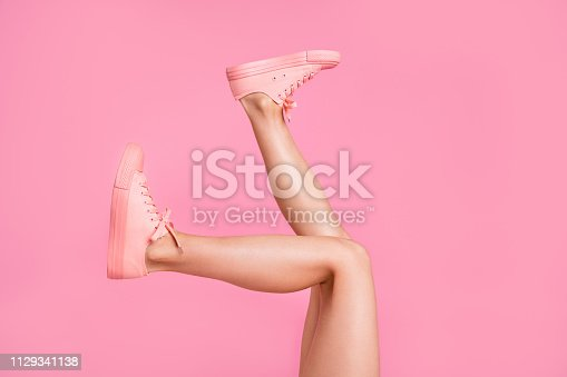 istock Cropped image view photo of nice attractive feminine girlish long fit slim thin shaven legs active sport walk go funny steps comfort zone isolated over pink pastel background 1129341138