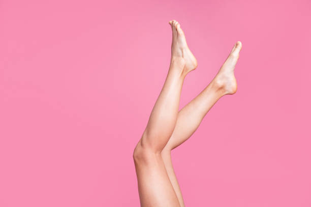 cropped image view photo of nice long attractive feminine fit thin slim soft smooth shine clear clean shaven legs ad advert isolated over pink pastel background - human leg stock photos and pictures