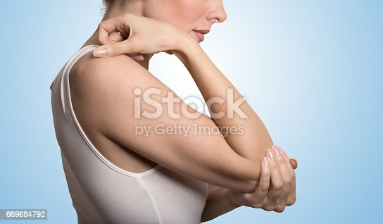 istock Cropped image woman with joint inflammation. Female's elbow 669684792