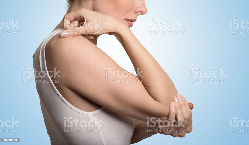 Cropped image woman with joint inflammation. Female's elbow stock photo