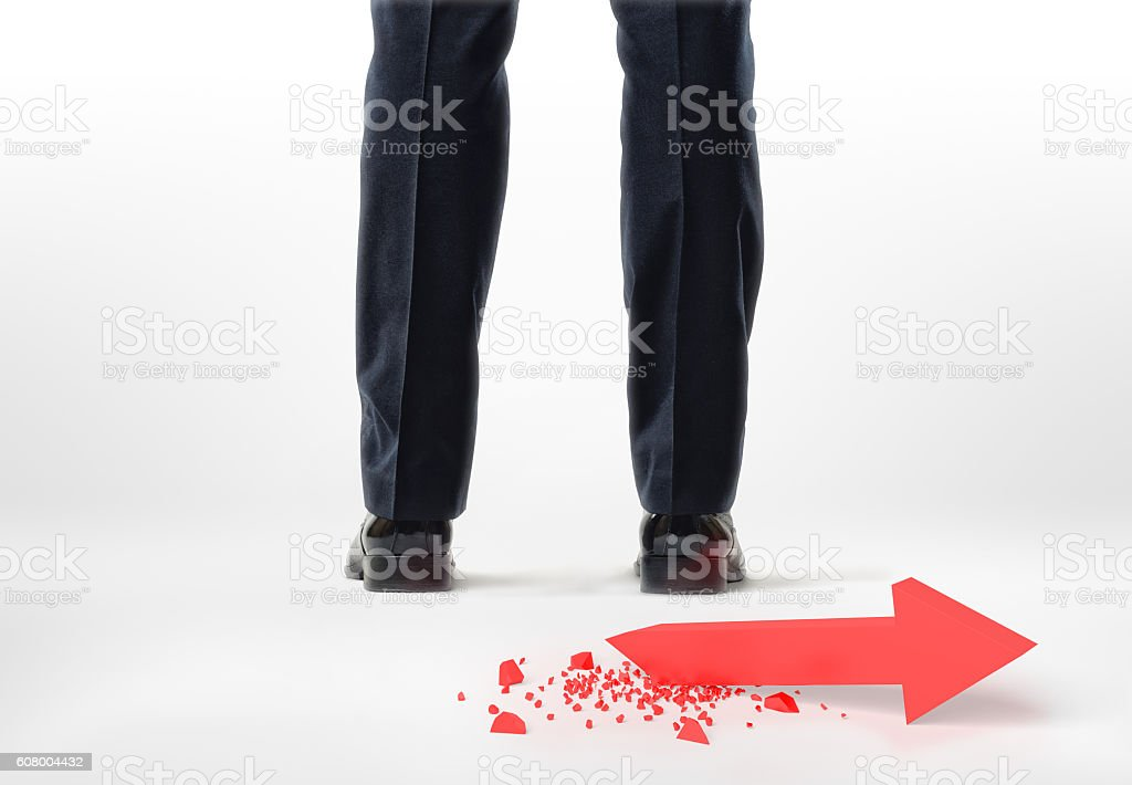 Cropped legs and feet of a businessman with red broken stock photo