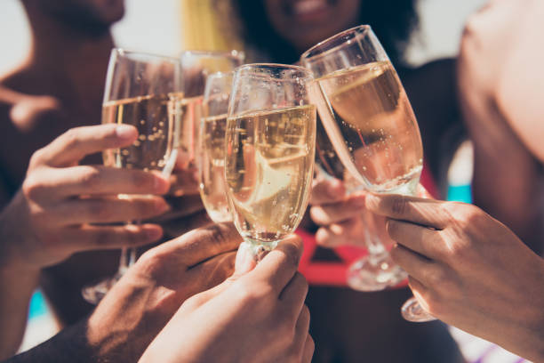 Cropped photo of many people hanging out clink glasses with champagne Cropped photo of many people, hanging out clink glasses with champagne champagne stock pictures, royalty-free photos & images