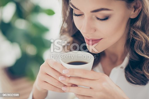 Cropped portrait of charming, pretty, nice, cute, trendy woman enjoying smell of tasty coffee with close eyes having natural make up morning pleasure ritual at home, idyllic concept