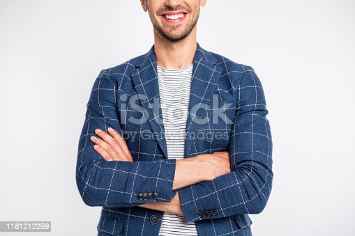 istock Cropped portrait of his he nice attractive cheerful businessman partner leader ceo boss chief head of HR department wearing blue checked blazer folded arms isolated over light white pastel background 1181212259