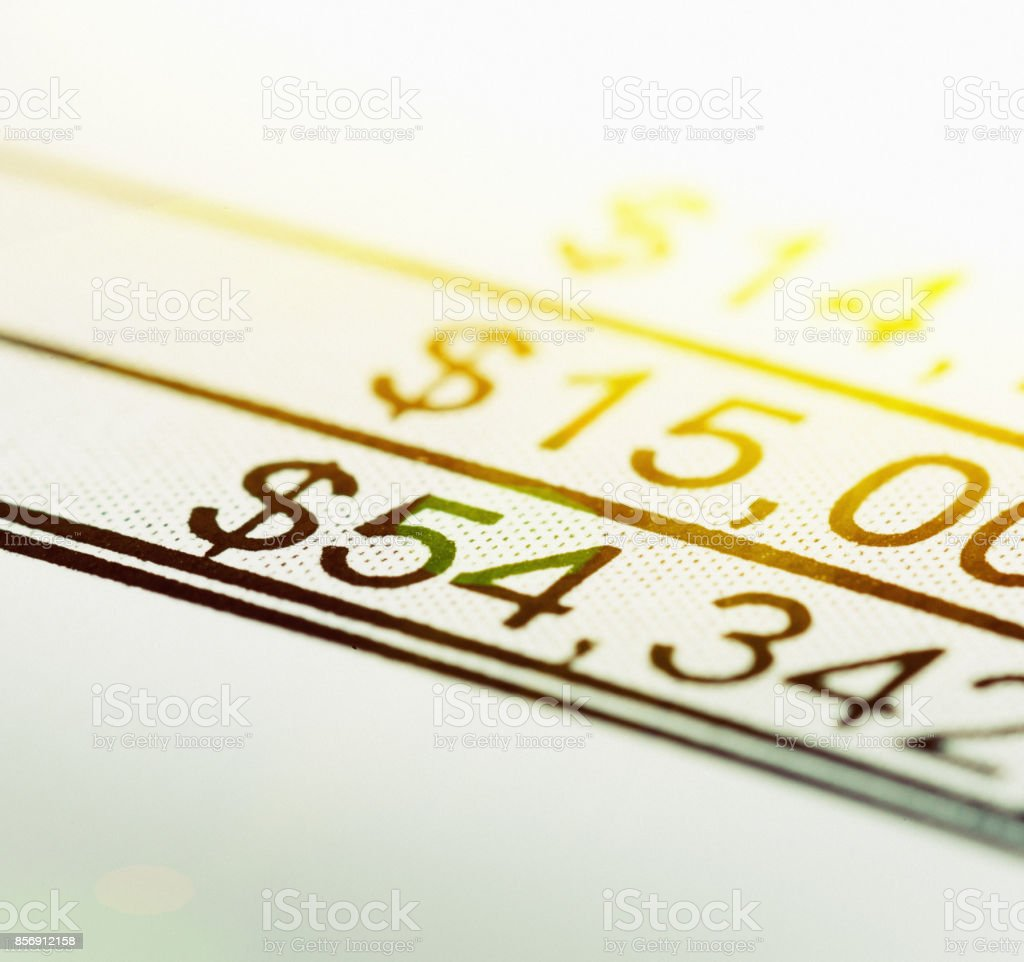 Cropped printout of dollar amounts being totalled stock photo