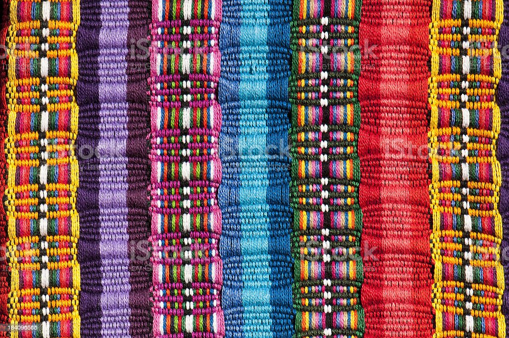 Cropped section of a Mexican blanket in bright colours royalty-free stock photo