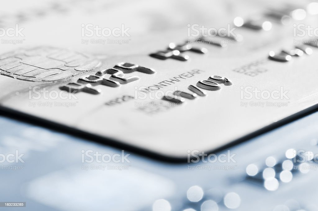 Cropped section of credit card with selective focus stock photo