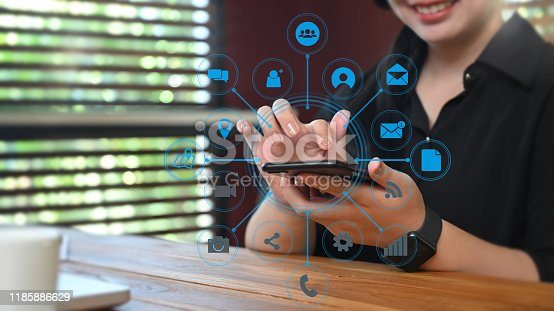 Cropped shot businesswoman using smartphone Digital marketing media in virtual screen.