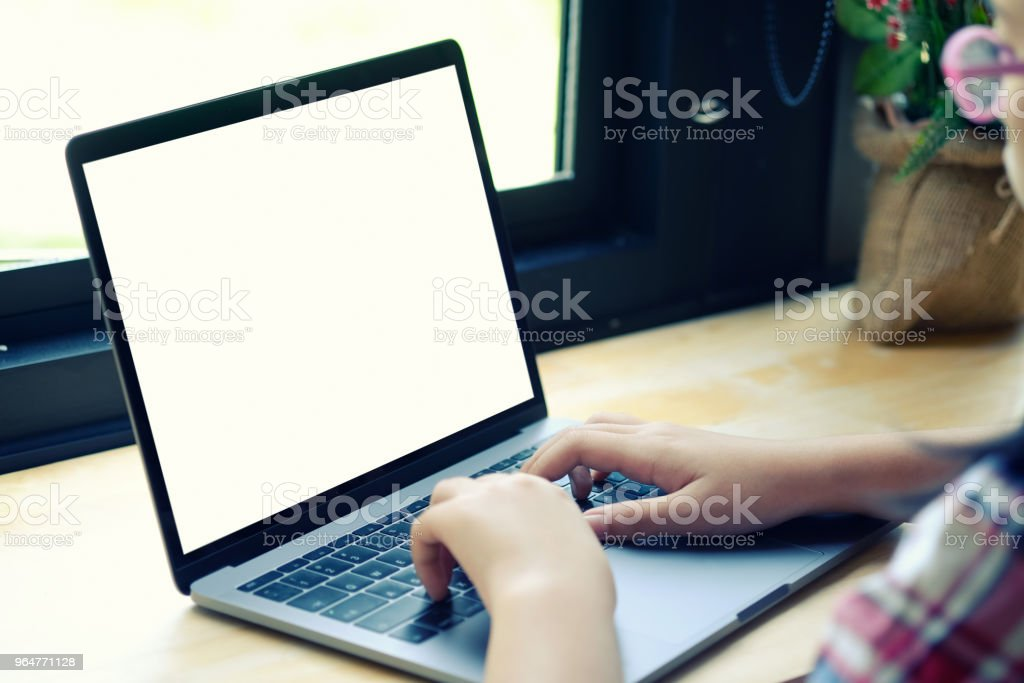 Cropped shot of an unrecognizable woman working on her laptop at home office. royalty-free stock photo