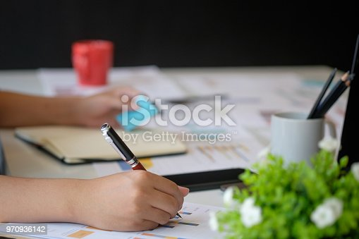 istock Cropped shot of audit man working on table. 970936142