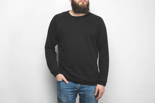 cropped shot of bearded man in black  isolated on white cropped shot of bearded man in black  isolated on white long sleeved stock pictures, royalty-free photos & images
