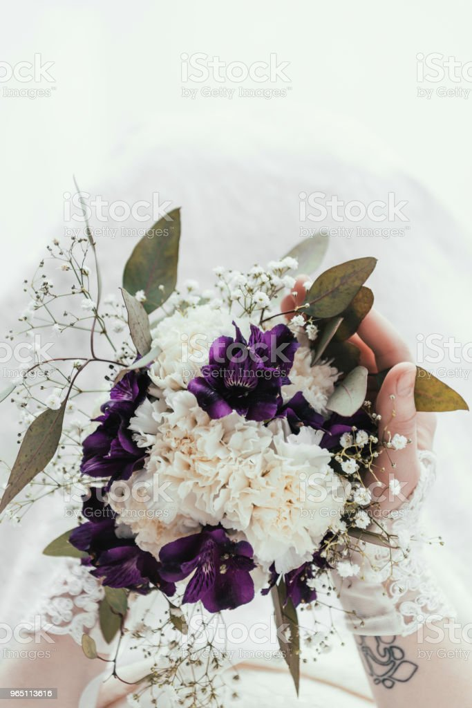 cropped shot of bride in white dress with beautiful wedding bouquet in hands royalty-free stock photo