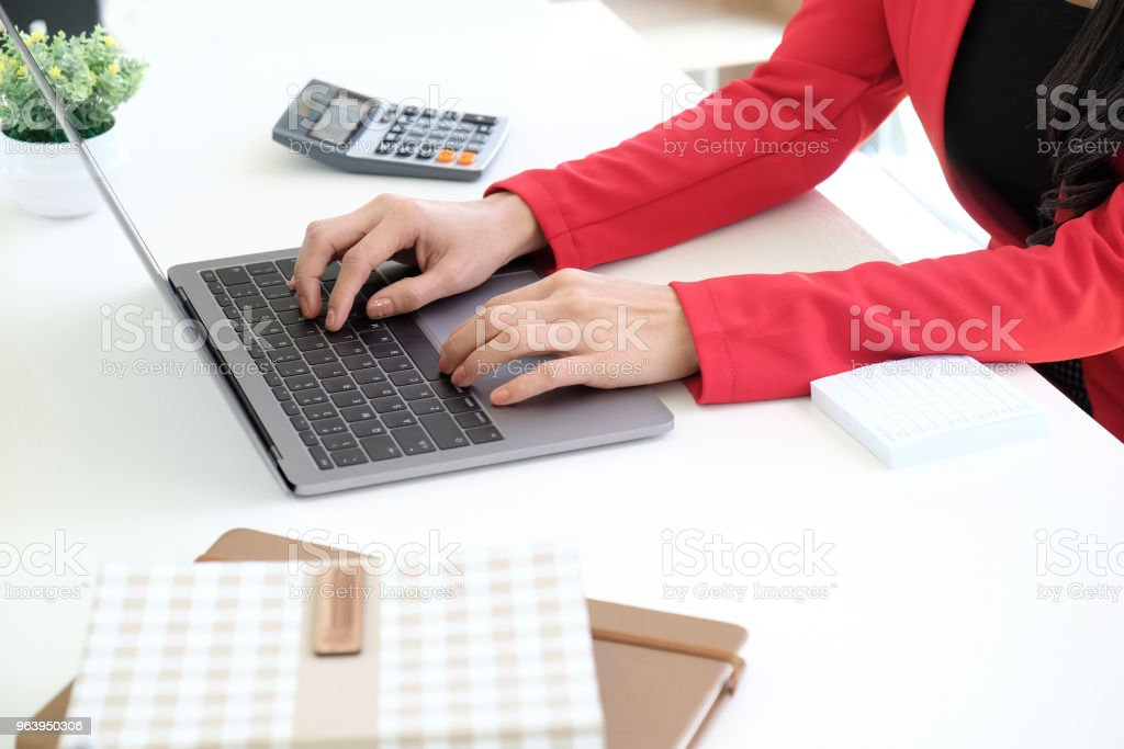 Cropped shot of businesswoman using laptop at her desk at studio office. - Royalty-free Accountancy Stock Photo
