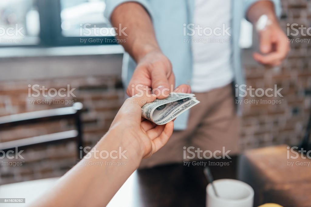 cropped shot of dad giving pocket money to daughter stock photo