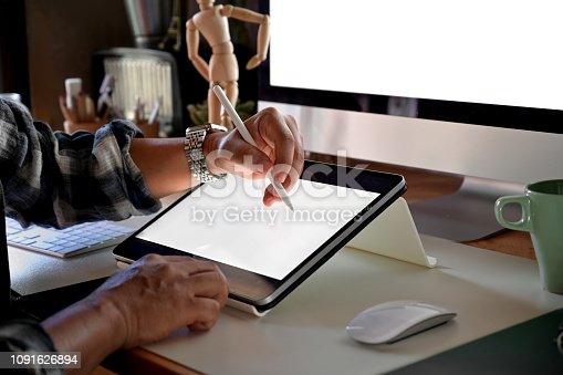 Cropped shot of designer sketch graphic drawing on digital display tablet creative  at workplace
