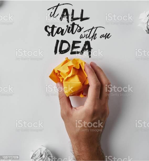 Cropped shot of man holding crumpled yellow paper with it all starts picture id1037727028?b=1&k=6&m=1037727028&s=612x612&h=i6tcnhyxsbrytsj4jzatfz8u3sqcj mudpcaqxs4o7e=