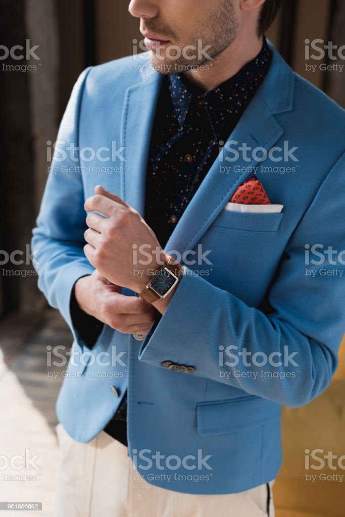 cropped shot of man in stylish blue jacket with wristwatch royalty-free stock photo