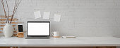 istock Cropped shot of minimal workspace with mock-up laptop, smartphone, decorations and copy space 1214639884