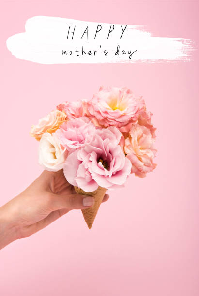 cropped shot of person holding waffle cone with beautiful blooming flowers isolated on pink - mothers day stock pictures, royalty-free photos & images
