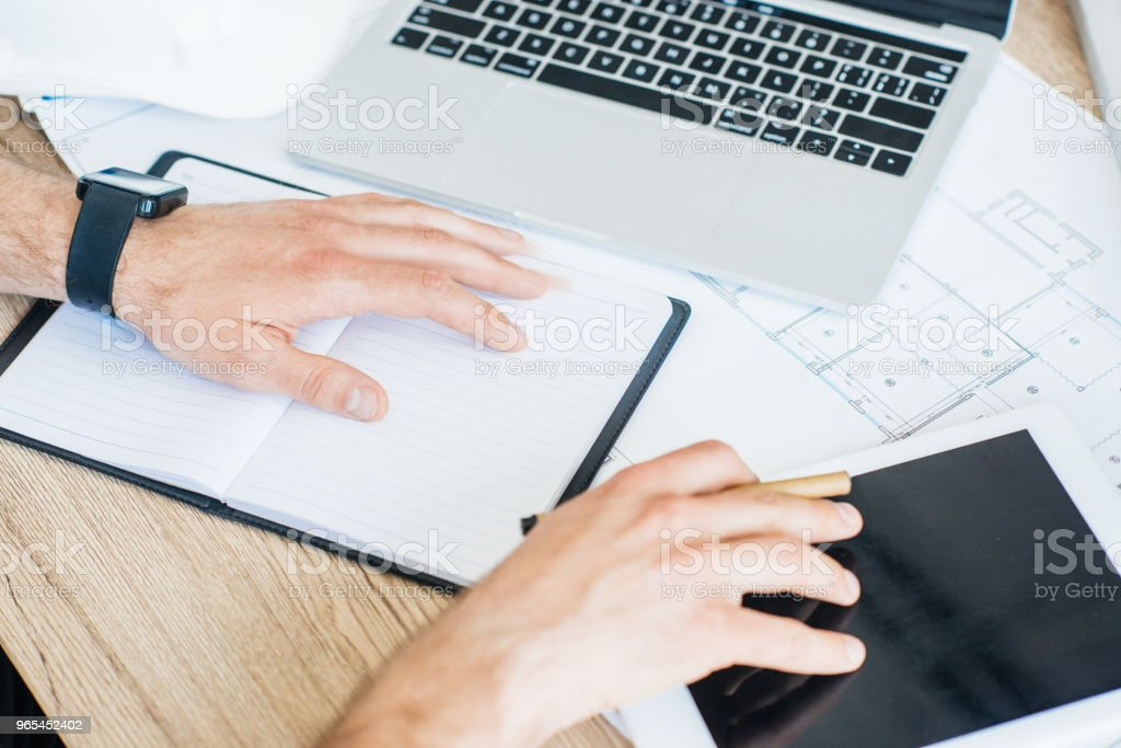 cropped shot of person using digital tablet at workplace royalty-free stock photo