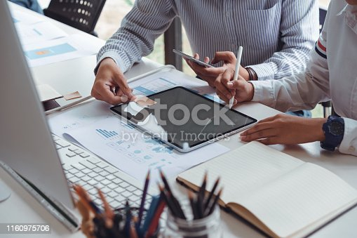 istock Cropped shot of startup UX UI front end designers drawing responsive web content or mobile app with graphics tablet.UX team designers sketching prototype and wireframe layout. 1160975706