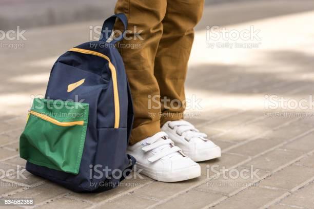 Cropped shot of stylish schoolboy standing with backpack on street picture id834582368?b=1&k=6&m=834582368&s=612x612&h=qyzi9a03ewtvqwyn61zm0r n cbyhfpvtmwv56r r7y=