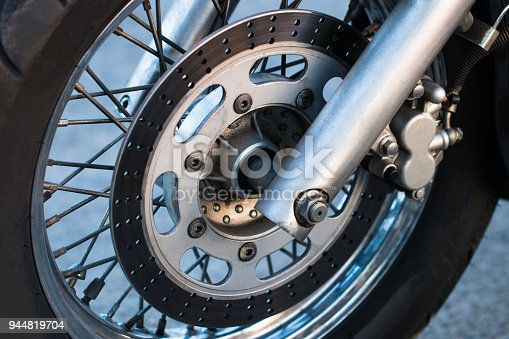 istock Cropped shot of the shot of the motorcycle forks, tire and front wheel. Disk brake system on a motorcycle. Freedom and travel concept 944819704